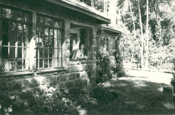 Donanne on the porch of the Rosslyn house with the terrible kitchen